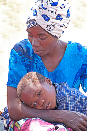 Tanzanian Woman and Orphaned Boy