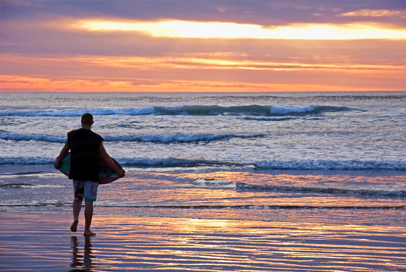 Surfboarder Watching Sunset